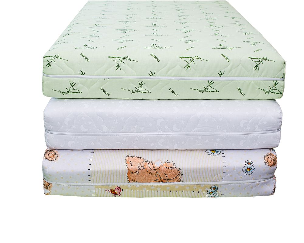Pile of three crib mattresses stacked on top of each other